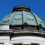 Historic dome renovation to include removal of existing copper metal on dome for reuse, repair of wood decking and framing as necessary installation of .060 fully-adhered EPDM rubber membrane, and reinstallation of copper dome.